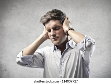 Man holding his hands over his ears