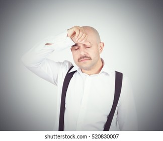 man holding his head pain. Closed eyes in pain. Headache. Migraine.
