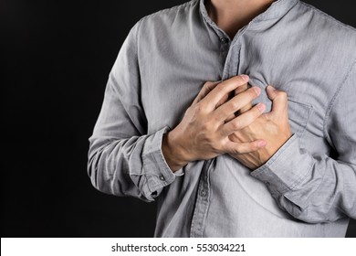 man holding his heart in pain with vintage color style photo
