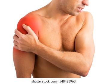 Man holding his hurting shoulder