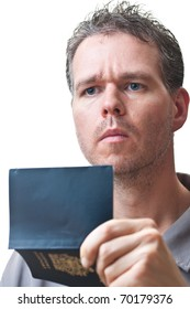A man holding his passport in front of himself, open, and looking up, isolated on white.