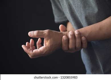 Man holding his wrist. Pain in a man wrist. Man massaging painful wrist. pain and healthy concept.