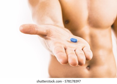 Man holding a HIV prevention pill. PrEP is an acronym standing for Pre-Exposure Prophylaxis.