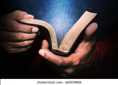 Man holding the Holy Bible.