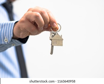 man holding a home key in his hand