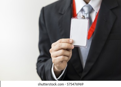 Man holding Identification white blank plastic id card.