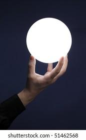 Man holding an illuminated sphere