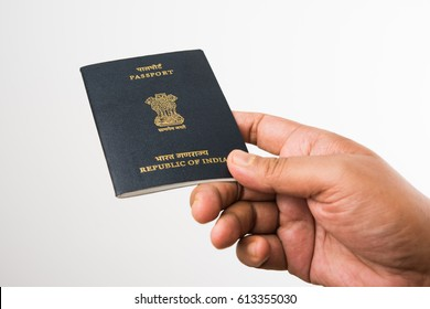 Man holding Indian Passport over white background, selective focus