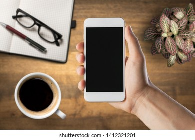Man holding iPhone X with Internet shopping service Aliexpress on the screen. iPhone 10 was created and developed by the Apple inc.