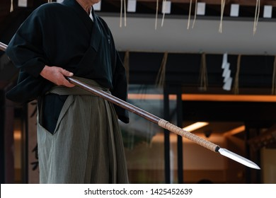 The man holding japanese spear