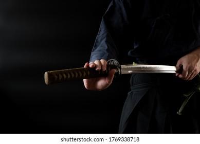 The man holding japanese sword