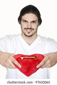 Man holding key with red heart