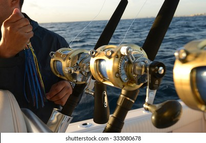 Man holding lure while deep sea saltwater fishing