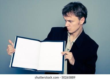 man holding a magazine
