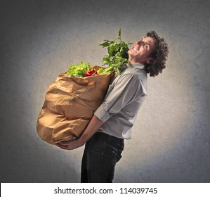 Man holding many vegetables