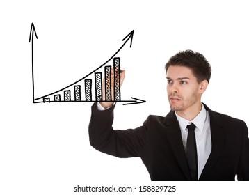 Man holding marker writing profit growth chart on white screen