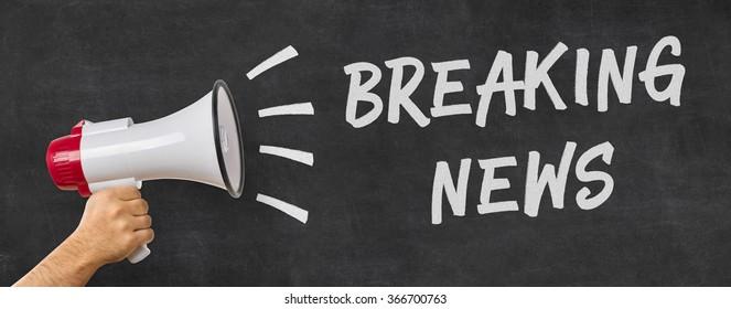 A man holding a megaphone - Breaking news