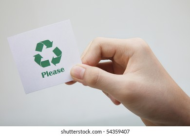 man holding a message-recycle please