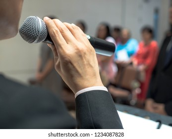 man holding microphone in the hand, Speaker at conference.