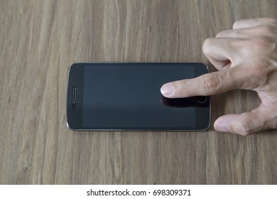 Man holding a Moblie Phone Space Gray