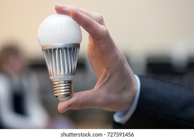 man is holding a modern led lamp