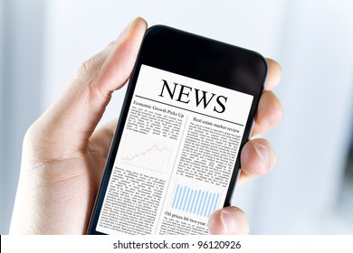 A man holding modern mobile smart phone with news article on screen. Closeup shot.