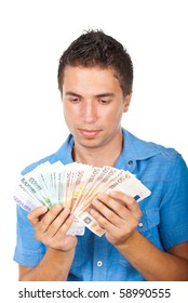 Man holding a lot of money and looking them isolated on white background