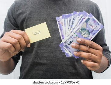 Man holding Money and Vote symbol in hand, concept of showing a cash for vote.