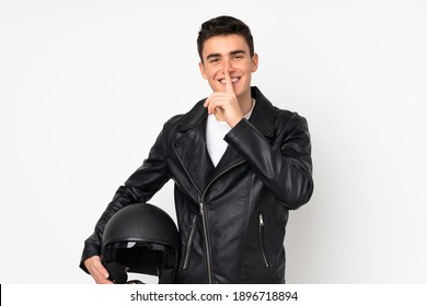 Man holding a motorcycle helmet isolated on white background doing silence gesture