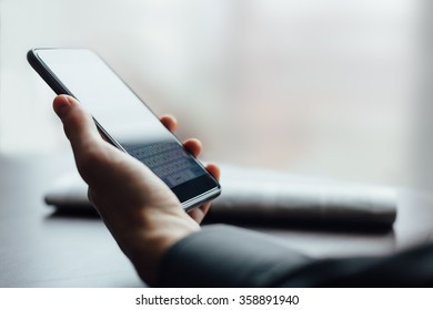 Man holding new mobile phone with copy space