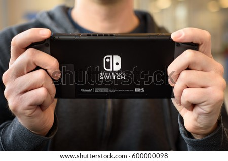 A man holding a Nintendo Switch console in Brewster, NY, USA on March 11, 2017.
