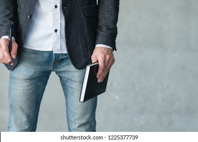 man holding notebook and pen. business plan and strategy development.