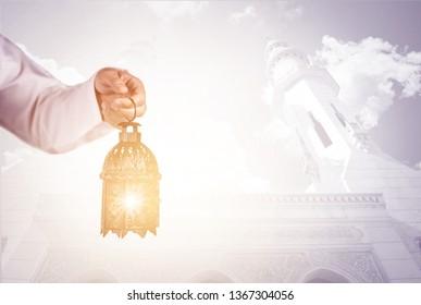 man holding old vintage lantern, Ramadan and Eid muslim concept
