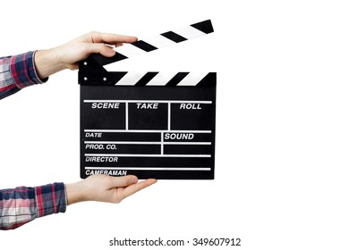 man holding an opened clapperboard