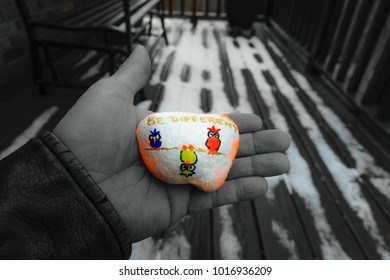 Man holding a painted rock