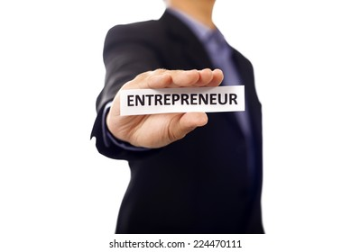 Man holding paper with entrepreneur text isolated over white background