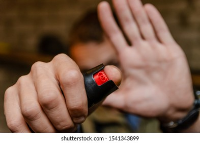Man holding pepper spray for self defense close up