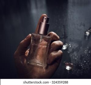 Man holding perfume