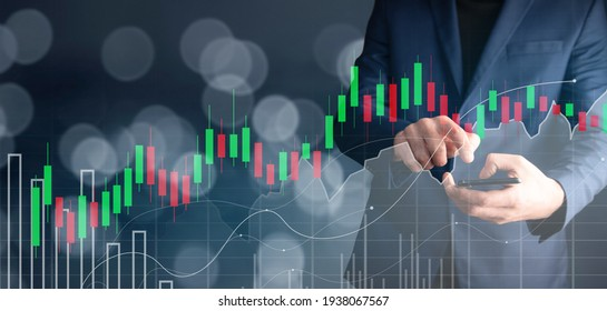 a man holding phone with forex graph