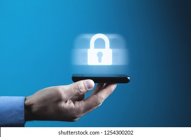 Man holding phone. Mobile and internet security concept