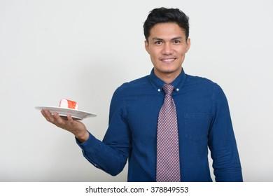 Man holding piece of cake
