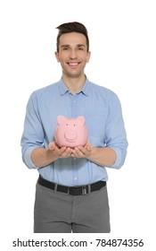 Man holding piggy bank on white background