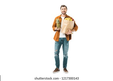 man holding pineapple and paper bag full of products isolated on white