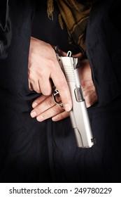 man holding a pistol close up