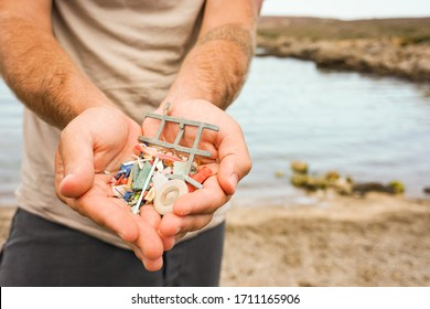 Man Holding Plastic waste from beach. Sustainability and Ecologist Concept. Ecofriendly Man.