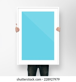 man holding poster mockup template with frame on white backgroun