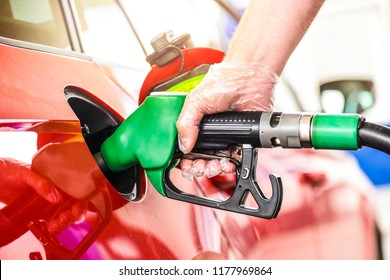Man holding pump and refueling gasoline at gas station.Petrol filling into car tank.