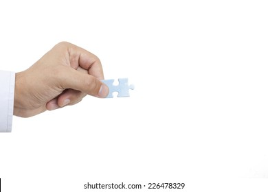 Man holding puzzle side view  with clipping path