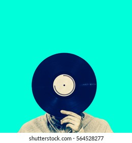 man holding record, isolated on green. art filter, music background