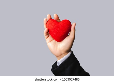Man holding a red heart.